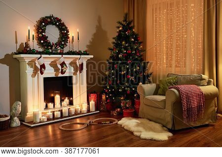 Christmas Room Interior Design, Xmas Tree Decorated Dy Lights Presents Gifts Toys, Candles And Garla