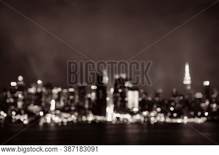 Manhattan midtown skyscrapers and New York City skyline bokeh at night
