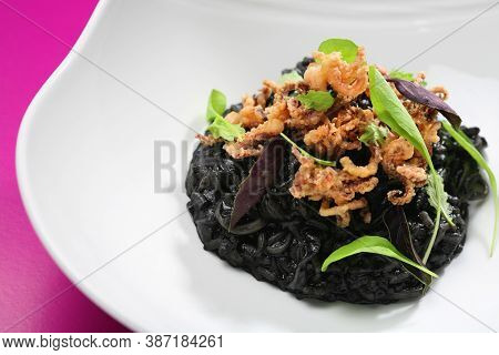 Risotto With Squid Ink And Battered Squid.