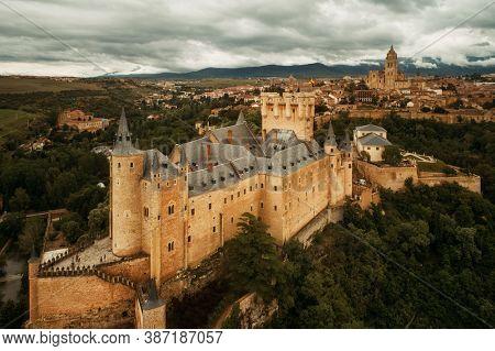 Alcazar of Segovia as the famous landmark aerial view in Spain.