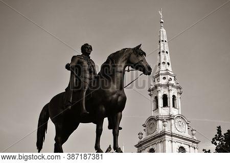 St Martin in the Field church in Trafalgar Square in London with statue