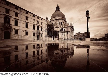 Venice Church Santa Maria della Salute and water reflection in Italy.