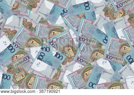100 Belorussian Rubles Bills Lies In Big Pile. Rich Life Conceptual Background