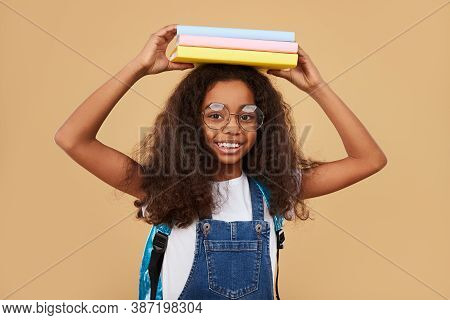 Cheerful Black Child In Glasses Smiling For Camera And Looking At Camera During School Studies Again