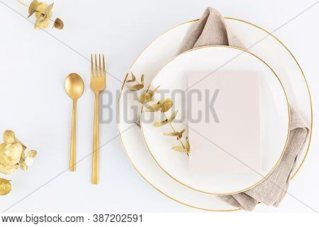 Festive Christmas, Wedding, Birthday Table Setting With Golden Cutlery And Porcelain Plate. Blank Ca