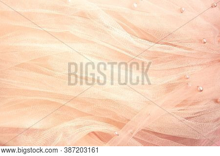 Beautiful Nude Pink Tulle With Shiny Beads Background. Draped Background Of Pink Powdery Fabric, Tex