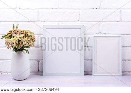 Two White Poster Frames Mockup With Pink Yarrow