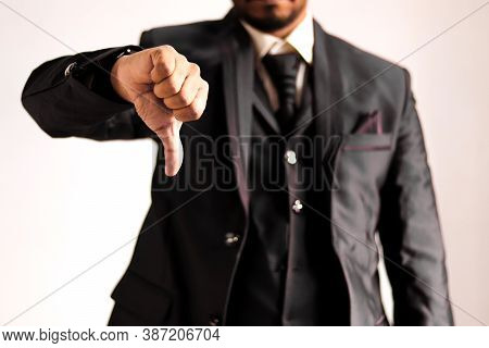 Businessman In Suit Showing Thumbs Down Negative Gesture Sign To Dislike, Unlike, Reject, Unhappy, N