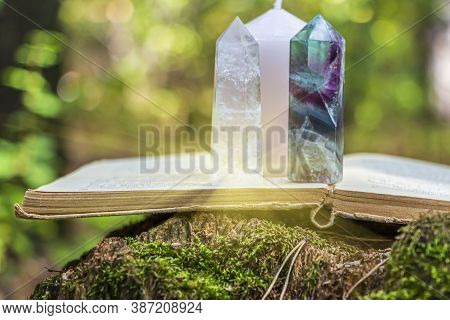 Magic Still Life With Fluorite, Quartz Crystal, Candle And Old Book. Rocks For Mystic Ritual, Witchc