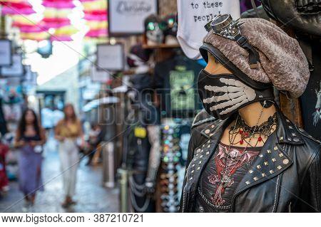London - September 14, 2020: Elaborately Dressed Mannequin Wearing A Skeleton Face Mask Outside A Ma