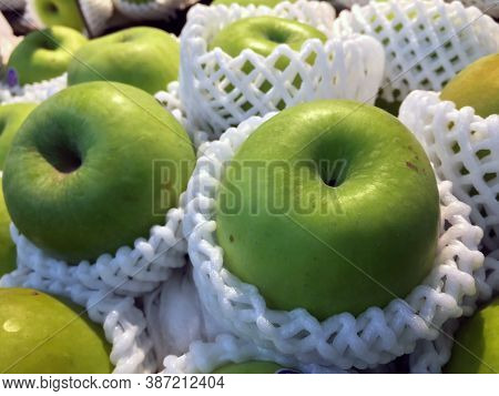 Pile Of Green Apple In The White Fruit Packagingfoam Net. It Is The Round Fruit Which Typically Has