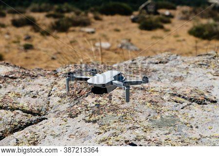 Avila, Spain - 28.06.2020 - Close Up Shoot Of A Dji Quadcopter Drone Mavic Mini. Drone Flying Over R