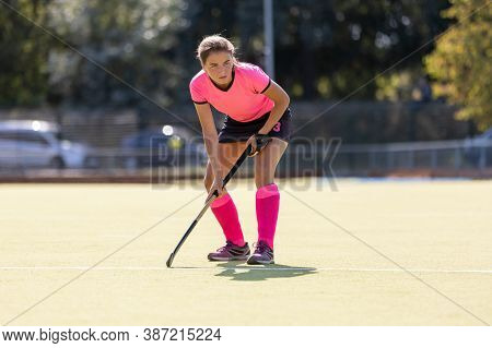 Young Female Field Hockey Player On The Pitch