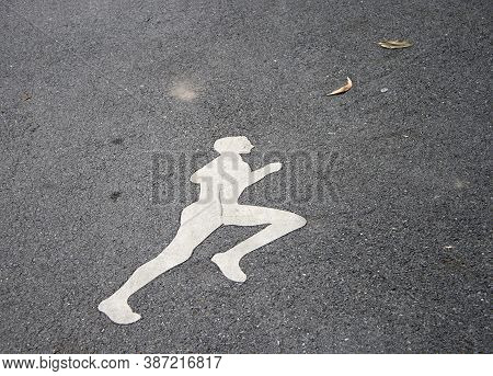 The White Jogging Man Painting On The Jogging Lane. Run At A Steady Gentle Pace, Especially On A Reg
