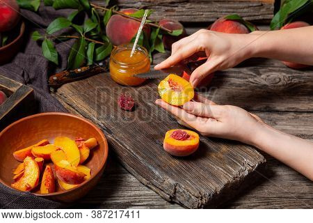 Peaches Whole Fruits With Leaves, Peaches In Halves, Peach Slices On Wooden Table. The Process Of Ma
