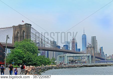 New York, Usa - June 05, 2019: Crowd Of Tourists And Local People Walking In Brooklyn Bridge Park Ne