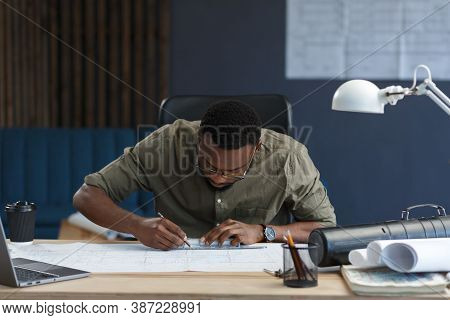 Afro-american Architect Working In Office With Blueprints.engineer Inspect Architectural Plan, Sketc