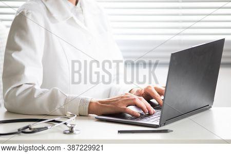 hands of doctor working on laptop tele medicine concept