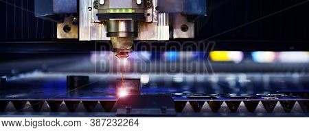 Raytools Laser Cut Head Machine While Cutting The Sheet Metal With The Sparking Light In Factory