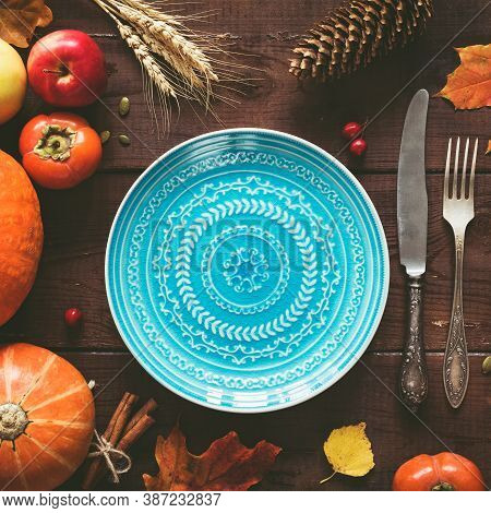 Autumn Halloween Or Thanksgiving Day Table Setting. Fallen Leaves, Pumpkins, Empty Plate And Vintage