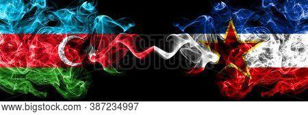 Azerbaijan, Azerbaijani Vs Yugoslavia Smoky Mystic Flags Placed Side By Side. Thick Colored Silky Ab