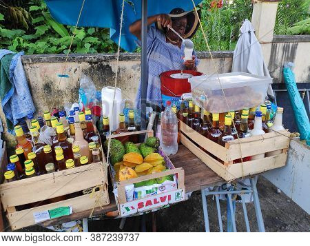 Guadeloupe, France - December 5, 2019: Street Vendor Serves Sorbet Coco (traditional Creole Cuisine