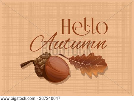 Acorn And Oak Leaf On A Burlap Background. Hello Autumn. Autumn Design Card With An Acorn And A Drie