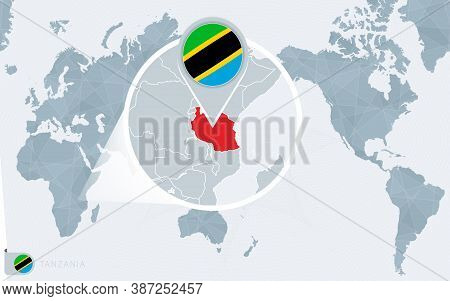 Pacific Centered World Map With Magnified Tanzania. Flag And Map Of Tanzania On Asia In Center World