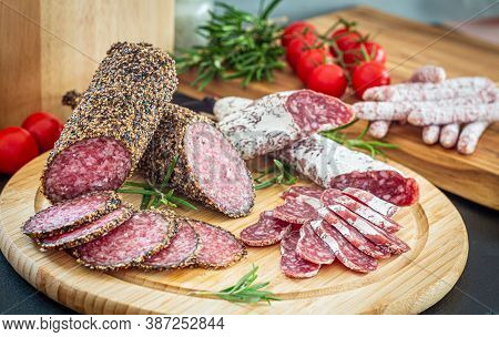 Assorted Sliced Italian Pork Salami On Wooden Plate