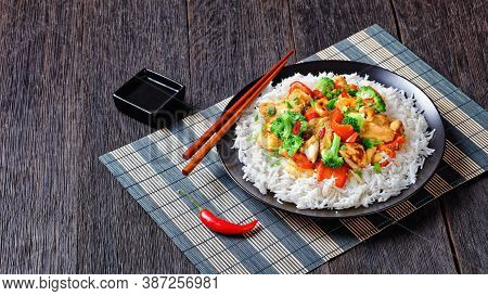 Thai Cashew Chicken With Vegetables Stir-fry: Broccoli, Sweet Pepper, Hot Red Chili, And Soya Sauce