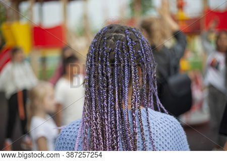 African Braids In A Child. They Are Braided Into The Hair. Lots Of Blue Braids. Hairstyle Of A Moder