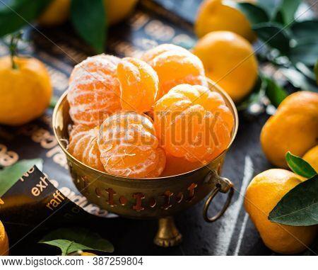 Fresh Juicy Tangerines In Black Bowl.peeled Orange In A Bowl.oranges In A Steel Bowl.oranges In Anti