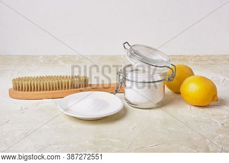 Citric Acid, Soda, Lemons And A Wooden Brush On A Light Background For Eco Cleaning, Natural And Non