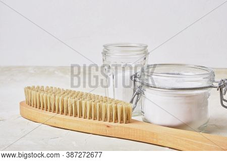 Wooden Brush, Citric Acid, Soda In Cans On A Light Background For Eco Cleaning, Natural And Non-toxi
