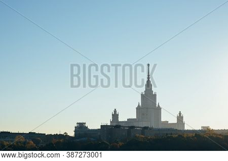 City Park With Autumn Colored Trees And Big Monumental Building In Background. There Is Lot Of Negat