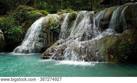Waterfall In The Jungle On The Island Of Mindanao, Philippines. Waterfall In The Rainforest.