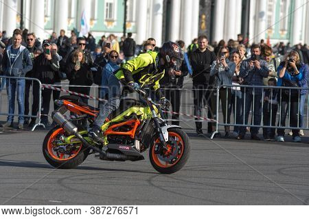 St Petersburg, Russia-september 26, 2020: Stunt Rider On His Bike Shows His Skills During Stunt Show