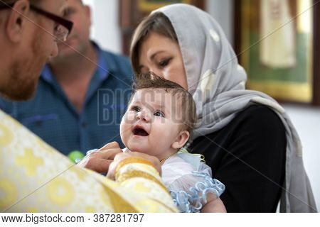 Belarus, The City Of Gomel. June 15, 2020. City Church. Baptism Of The Child. Mother Holds The Baby