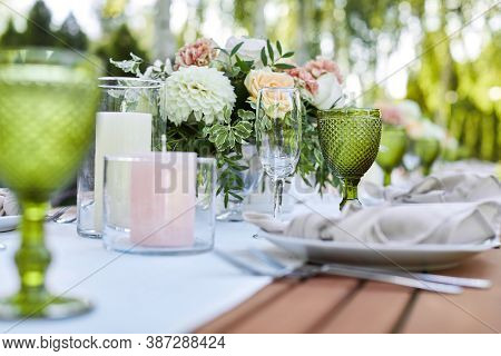 Dinner Tables With White Cloth, Served With Porcelain And Green Glasses. Georgeous Wedding Table Dec