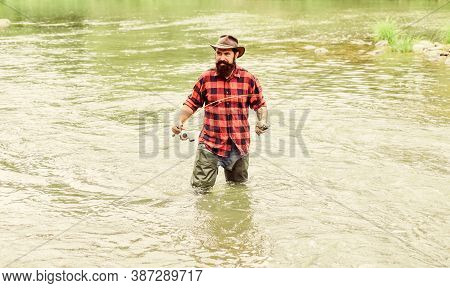 Man Bearded Fisher. Fishing Requires To Be Mindful And Fully Present In Moment. Fisher Fishing Equip