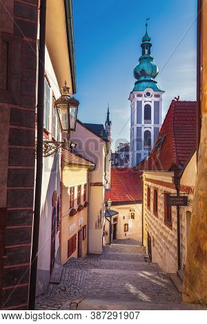 Street Of The Old Town - Castle Stairs, In The Background The Tower Of The Church Of St. Jost, Cesky