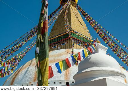 The Upper Part Of The Boudhanath Stupa In Kathmandu, Nepal. The Image Of Buddhas Eyes On A Gold Surf