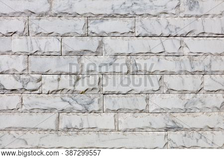 Wall Background And Texture Of Gray Marble Tiles With Chips Around The Perimeter And Brown Veins On