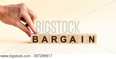 Woman Made Word Bargain With Wood Blocks