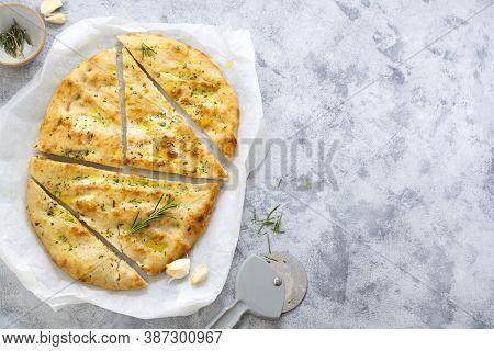 Garlic Foccacia Bread. Freshly Baked Flat Garlic Bread, Olive Oil And Herbs.
