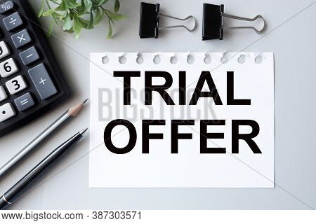 Trial Offer. Text On White Paper On Gray Background