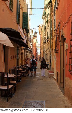 Portovenere, Five Lands, Italy - Summer2020: Tourists With Backpacks Walk The Streets Of Portovenere