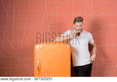 Man Hold Cup Of Tea Or Coffee In Kitchen. Macho Drink At Retro Fridge On Pink Background. Bachelor W