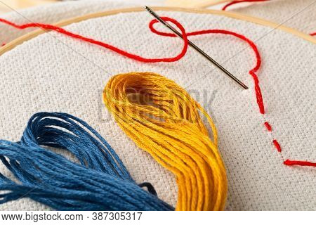 Round Stitching Or Embroidery Frame With Red Stitching And Stitching Yarn, Selective Focus