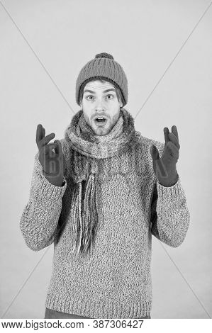 Shocked Man Feeling Cold In Winter. No Flu. Winter Weather Forecast. Guy Wear Warm Clothes. Male Kni
